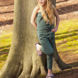 Funny happy young blonde girl in green park. — Stock Photo