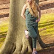 Funny happy young blonde girl in green park. — Stock Photo #26713179