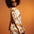 Retro 70s fashion african woman with paisley dress and sunglasse — Stock Photo #26782983