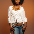 Vintage 70s fashion afro woman. White shirt and jeans against br — Stock Photo