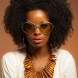 Retro 70s fashion black woman with sunglasses and white shirt. B — Stock Photo #26782499