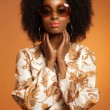 Retro 70s fashion african woman with paisley dress and sunglasse — Stock Photo #26782615