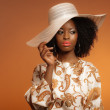 Retro 70s fashion afro woman with paisley dress and white hat. B — Stock Photo #26782735