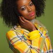 Stock Photo: Afro woman in vintage seventies fashion style. Yellow jacket and