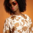 Retro 70s fashion african woman with paisley dress and sunglasse — Stok fotoğraf