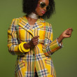 Dancing retro 70s fashion african woman with sunglasses. Yellow — Stok fotoğraf