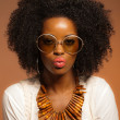 Stockfoto: Retro 70s fashion black womwith sunglasses and white shirt. B