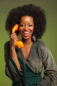 Retro 70s afro módní ženu s zelené šaty. volání s oran — Stock fotografie