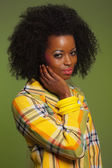 Afro woman in vintage seventies fashion style. Yellow jacket and — Stock Photo