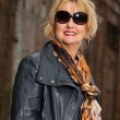 Pretty middle aged woman with blonde hair and black sunglasses.  — Stock Photo