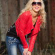 Pretty young woman with long blonde hair and black sunglasses. U — Stock Photo #27163381