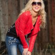 Stock Photo: Pretty young woman with long blonde hair and black sunglasses. U