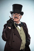 Vintage dickens style man with moustache and hat. Smoking cigar. — Stock Photo