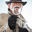 Vintage detective with mustache and hat. Looking through magnify — Stock Photo