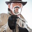 Stock Photo: Vintage detective with mustache and hat. Looking through magnify