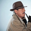 Vintage detective with mustache and hat. Smoking pipe. Studio sh — Stock Photo #27482937