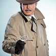 Retro detective with mustache and hat. Looking through magnifyin — Stock Photo #27482941