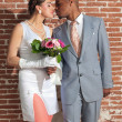 Vintage fashion kissing wedding couple in old urban building. Mi — Stockfoto