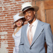 Retro jazz fashion wedding couple in old urban building. Groom i — Stock Photo