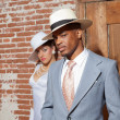 Retro jazz fashion wedding couple in old urban building. Groom i — Stock Photo #27836347