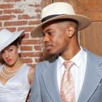 Retro jazz fashion wedding couple in old urban building. Groom i — Stock Photo #27840135