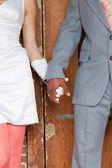 Closeup of holding hands of stylish wedding couple. Mixed race. — Stock Photo