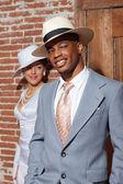 Retro jazz fashion wedding couple in old urban building. Groom i — Stock Photo