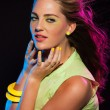 Sexy retro 80s fashion disco girl with long blonde hair and gree — Stock Photo