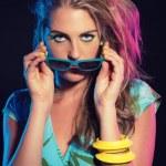 Sensual retro 80s fashion girl with blue tropical dress, long bl — Stock Photo