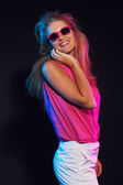 Sexy retro 80s fashion disco girl with long blonde hair and sung — Stock Photo