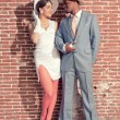 Stock Photo: Vintage fashion romantic wedding couple in old urban building. M