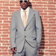Vintage fashion cool afro american groom with sunglasses against — Stock Photo #28609795