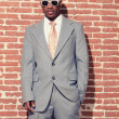 Vintage fashion cool afro american groom with sunglasses against — Stock Photo
