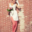 Vintage romantic sensual bride against old brick wall. Urban env — Stock Photo #28609815