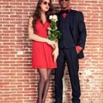 Urban cool retro fashion mixed race wedding couple wearing black — Stock Photo #28609829