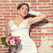 Vintage romantic sensual bride against old brick wall. Urban env — Stock Photo #28609903
