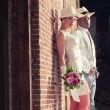 Vintage fashion romantic wedding couple in old urbbuilding. M — Stock Photo #28609933