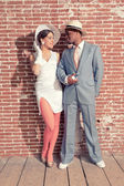 Vintage fashion romantic wedding couple in old urban building. M — Stock Photo