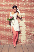 Vintage romantic sensual bride against old brick wall. Urban env — Stock Photo