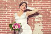 Vintage romantic sensual bride against old brick wall. Urban env — Stock Photo