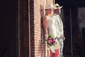 Vintage fashion romantic wedding couple in old urban building. M — Stock Photo