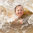 Kid boy having fun at the beach in the waves of the ocean. — Stock Photo