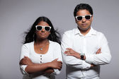 Young hip indian couple. Wearing white shirt and sunglasses. Stu — Stock Photo