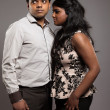 Fashionable passionate indian couple. Studio shot against grey. — Stock Photo #29018987