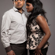 Fashionable passionate indian couple. Studio shot against grey. — Stock Photo #29022787