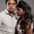 Fashionable passionate indian couple. Studio shot against grey. — Stock Photo