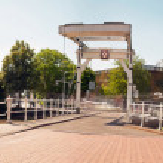 Panoramic photo of dutch city Leiden in summer. Bridge at Morspo — Stock Photo #29225229
