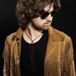 Cool rock style musician with long brown hair and beard. Wearing — Stock Photo #31576851
