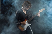 Psychedelic rock guitarist with long brown hair and beard. Dress — Stock Photo
