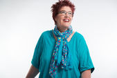 Happy smiling middle aged woman with red short hair and glasses. — Stock Photo